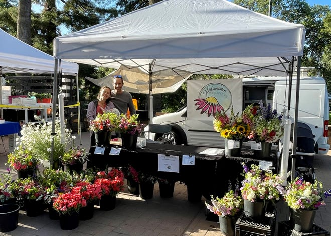 """Flower farmer Monica Drazba with husband, Tommy Stromberg, and their son, Oskar, started Midsummer Flowers after purchasing a small farm near Vacaville, California. They now sell their locally grown flowers weekly at the Vacaville Farmers Market. """"It's been a joy connecting with the community this way,"""" she says."""