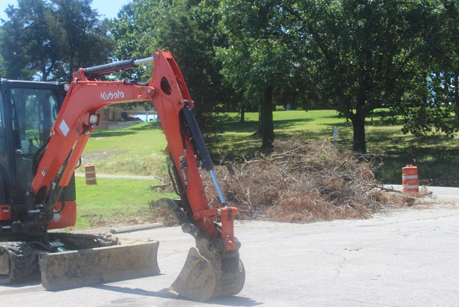 Express Tree and Landscaping is working at City Park in Van Buren to clean up debris that has been leftover from the May 3 tornado.