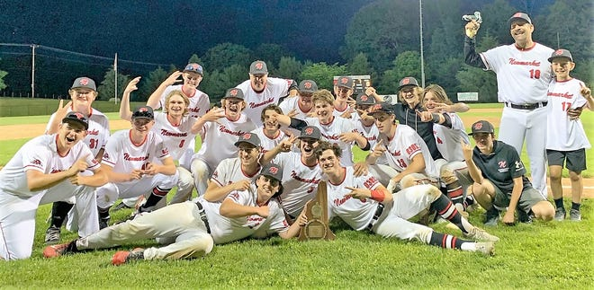 Members of the Newmarket High School baseball team celebrate after Saturday's 10-0 win over Littleton in the Division IV state championship at Robbie Mills Park in Laconia.