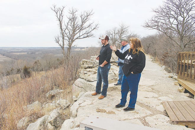 Tour guide Sandy Randall tells visitors about the conflux of the Arkansas City and Walnut Rivers where Indian artifacts, Spanish artillery and mysterious rock art are visible along the banks of the ever-changing rivers, from Inspiration Point which overlooks the location at Camp Horizon near Arkansas City.