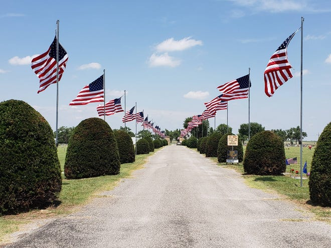 Flags fly at Fairview Cemetery as the City of Greensburg reviews tree board members and conducts business reguarding dogs, police and committee members.