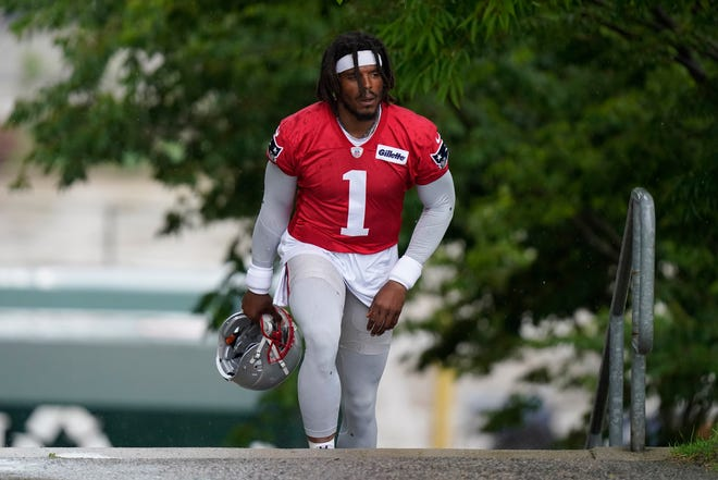 New England Patriots quarterback Cam Newton (1) steps on the field for an NFL football practice, Monday, June 14, 2021, in Foxborough, Mass. (AP Photo/Steven Senne) ORG XMIT: MASR10