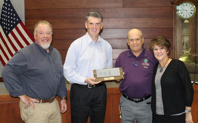 Morgan County Commissioner Kenny Hale, center right, is presented with an award of appreciation from RDC members Troy Sprinkle, left, Daniel Elliott and Kim Merideth.