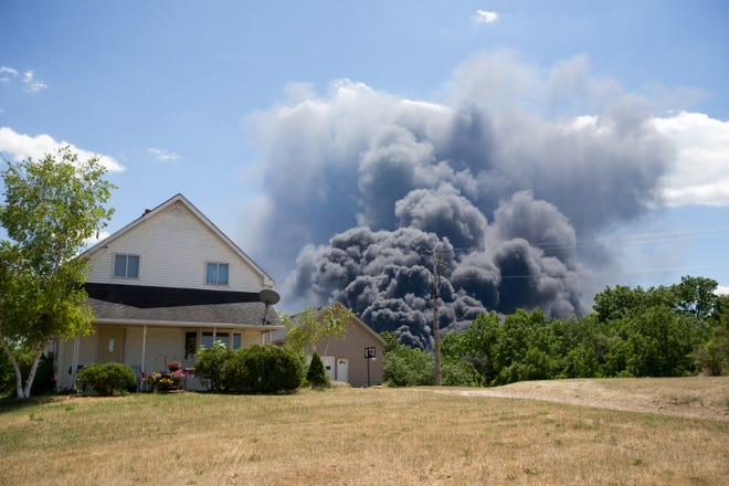 """Several lawsuits have already been filed over a massive Chemtool industrial fire and lawyers say to expect """"hundreds"""" more. In this file photo, a black smoke cloud from the massive industrial fire at Chemtool on Prairie Hill Road in Rockton billows over a house on S. Bluff Road Monday, June 14, 2021, in South Beloit."""