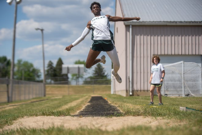 Boylan's Darcis Bitangalo practices his triple jump with jumping coach Ann Marie Coyle watching at Boylan High School on Monday, June 14, 2021 in Rockford.