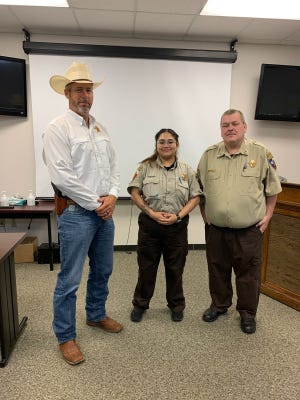 Erath County Sheriff Matt Coates, left, recently announced the promotion of Officer Mayra Guiterrez, center, to the rank of sergeant.