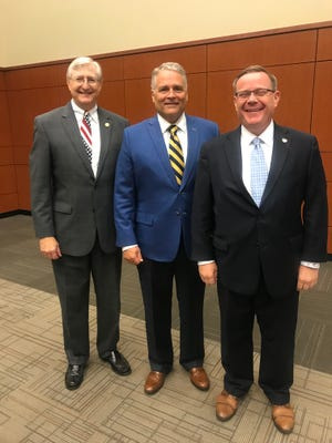 From left, Senator Ted Alexander, Representative Kelly Hastings and Speaker of the House Tim Moore pose for a photo after the Legislative Breakfast Monday morning, June 14, 2021.