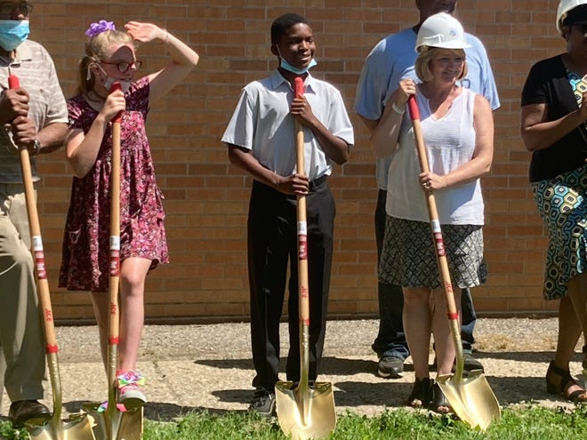 Superintendent Jennifer Gill takes part in a ceremonial groundbreaking at Jefferson Middle School in Springfield Monday, along with a number of Jefferson students. The middle school, which dates from 1957, will get a newall-purpose room, outdoor seating, new elevators, new classroom space and work areas and new andrenovated bathrooms. A groundbreaking was also held at Washington Middle School earlier Monday.