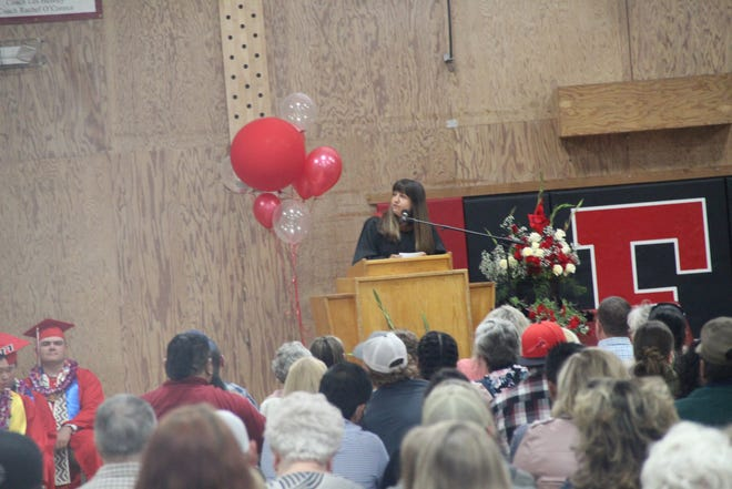 Kristy Franklin gives the student address at the the Etna High School graduation on Friday.