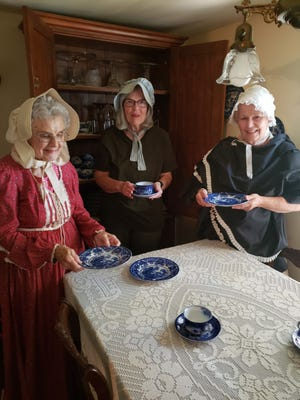 Officers of the Kewanee Chapter of the DAR, from left, Regent Rebecca Heaton, Registrar Gail Ripka and Treasurer Margie Tossell, show off the Flo Blue China used by the local chapter for their first Colonial Tea held at the DAR house on Park Avenue in October of 1904.