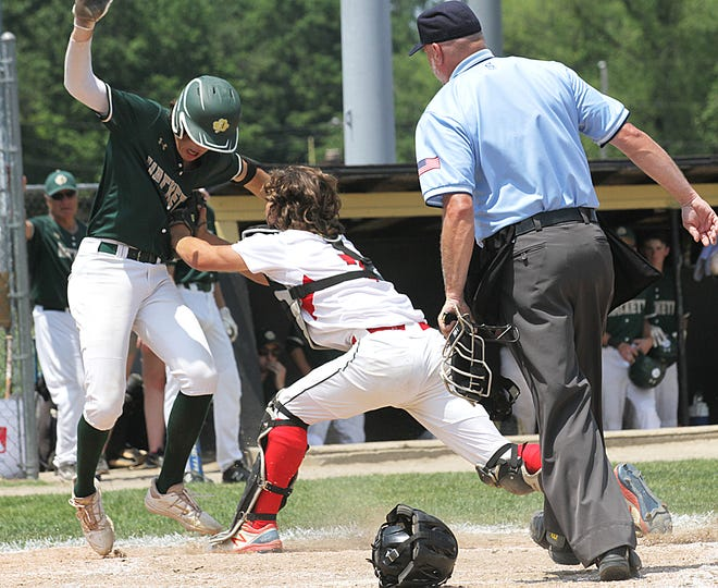 Colon catcher Josh West tags out a Hackett baserunner following a relay to the plate in regional action on Saturday.