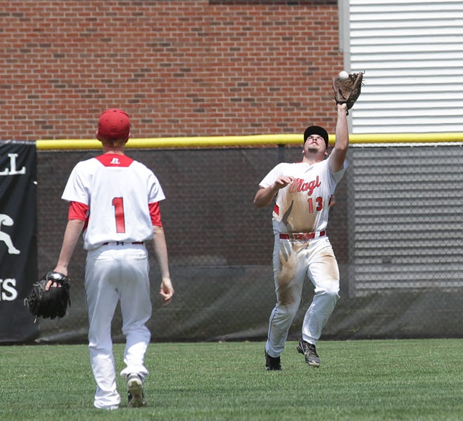 Brandon Crawford of Colon makes a catch for an out against Hackett in center field on Saturday.