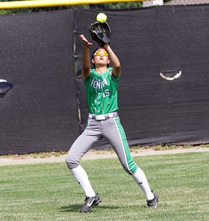 Chloe Behrends of Mendon makes a catch for an out against Kalamazoo Christian on Saturday.