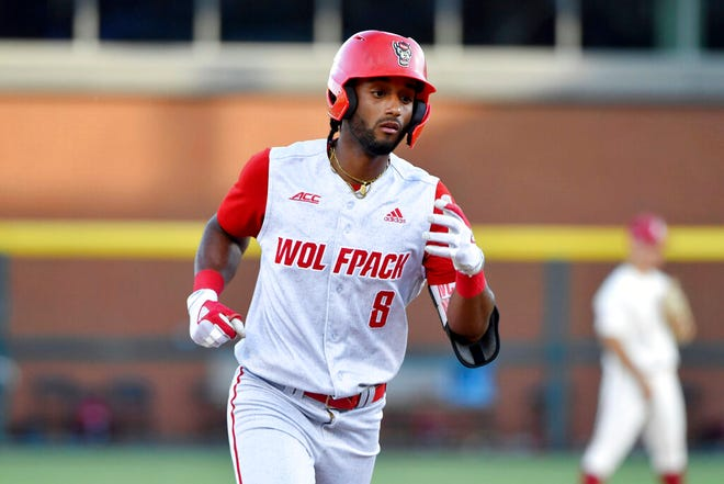 North Carolina State's Jose Torres (8) rounds the bases after hitting the go-ahead home run against Arkansas in the ninth inning of an NCAA college baseball super regional game Sunday, June 13, 2021, in Fayetteville, Ark. (AP Photo/Michael Woods)