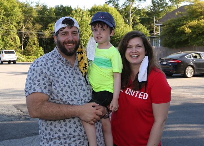 Jeff, Owen and Lauren Houle enjoy the evening at the United Way Clammed Up! fundraiser held Friday, June 12, 2020 at Mike's Restaurant in Fairhaven.