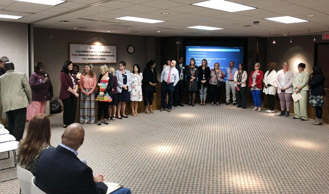 The Topeka Unified School District 501 Board of Education meets in person in 2019. The board is one of a handful in Kansas still meeting remotely due to the COVID-19 pandemic, although that could soon change.