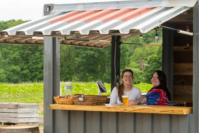 Cindy Swanson, left, and Ashley Letourneau inside the Sunflower Shanty at Houlden Farm.