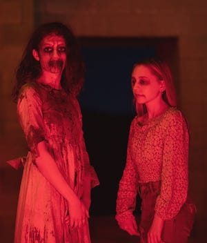 Filming for 'KINDEr' took place at the Old Stone Church, in West Boylston, on Saturday, June 12. Kaitlyn Archambault (left) , of Princeton, is playing a demon girl along side Harper Peyton O'Kelley, of Albany, N.Y.