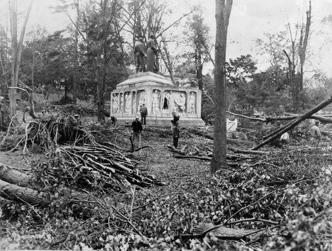 """This photo from September 1938 shows the damage from the major hurricane months earlier. The Evening Gazette said the trees near the Rogers-Kennedy Memorial """"dropped like ten pins."""""""