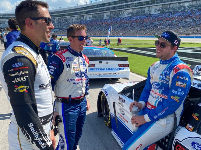 Mitchell's Chase Briscoe (right) chats with his crew chief Johnny Klausmeier (middle) fellow driver Aric Almirola (left) prior to Sunday's NASCAR All-Star Open at Texas Motor Speedway.