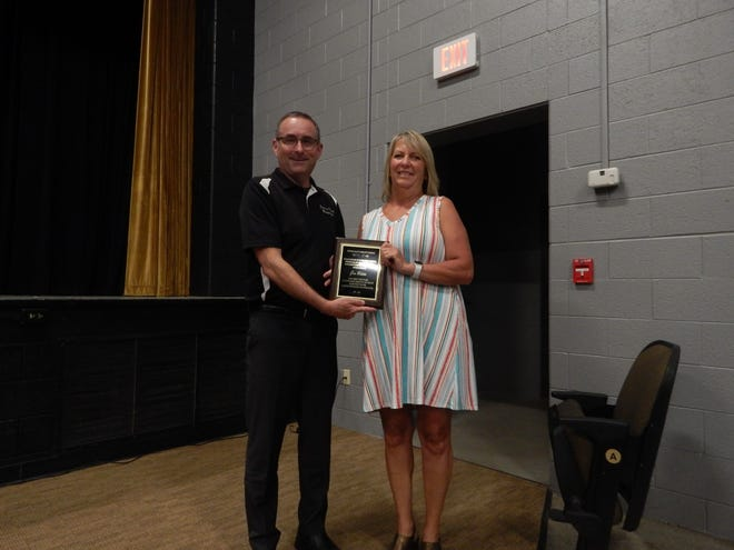 Elementary teacher Gina Webster was presented a plaque commemoriating her 34 years at Springs Valley Elementary by the school board on June 7. Superintendent Dr. Trevor Apple presented the plaque.