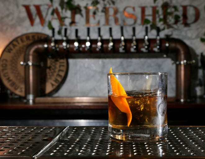 Watershed Kitchen & Bar's signature cocktail is the Barrel-Aged Old Fashioned.