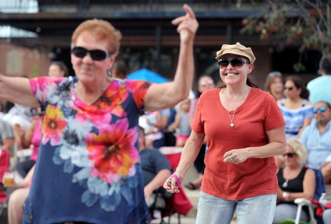 Malia Lautner (right) dances with her mother, Annie Lautner, both of Hilliard, as the Reaganomics perform during the second Celebration at the Station concert of the season June 10 at Hilliard's Station Park in Old Hilliard.