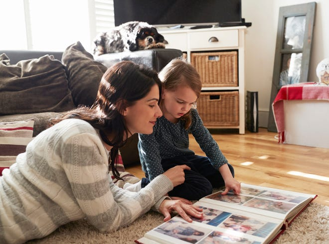 A mother and daughter look through family photos