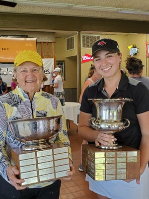 Jean Shivers, left, and Charlotte Davis hold their trophies after winning their respective divisions at the Corpus Christi Women's Golf Association City Match Place Championship on June 12 at Oso Beach Golf Course in Corpus Christi, Texas.