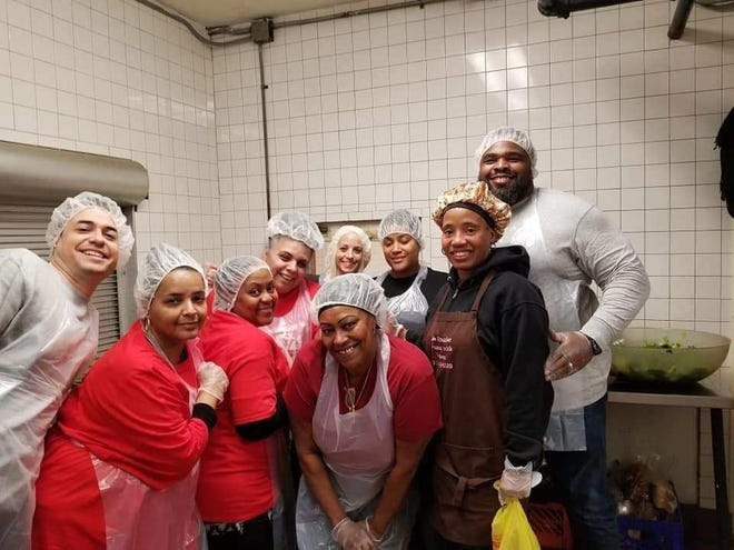 Artoria 'Dee' Frazier (far left, black hoodie) helped feed the homeless and hungry in Camden and Trenton.