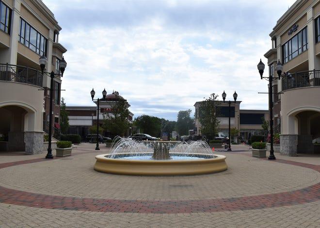 A pedestrian plaza with a fountain would become a street leading to a new hotel under plans for a complex at the former Garden State Park racetrack in Cherry Hill.