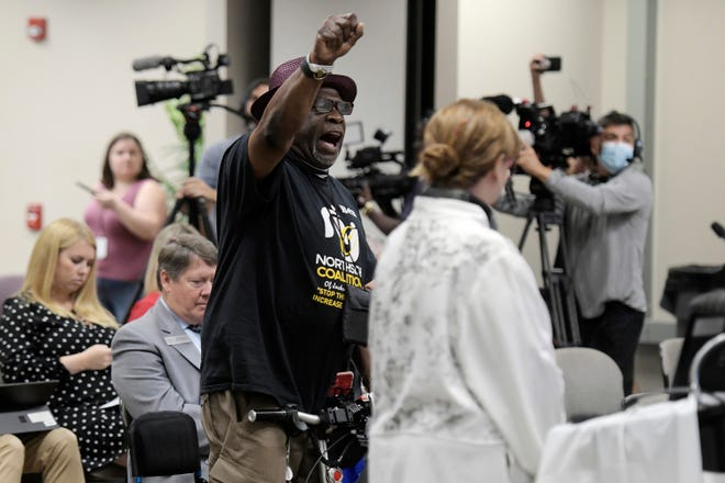 """Ben Frazier, founder of the Northside Coalition of Jacksonville, chants """"Allow teachers to teach the truth"""" at the end of his public comments opposing a ban on the teaching of critical race theory in public schools at a Department of Education meeting in Jacksonville on June 10."""