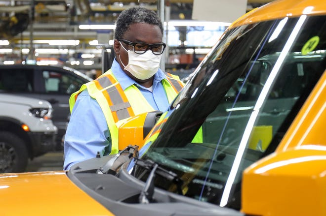 Plant manager Erik Williams looks over a the new Ford Bronco on Monday, June 14, 2021, at the Michigan Assembly Plant in Wayne.