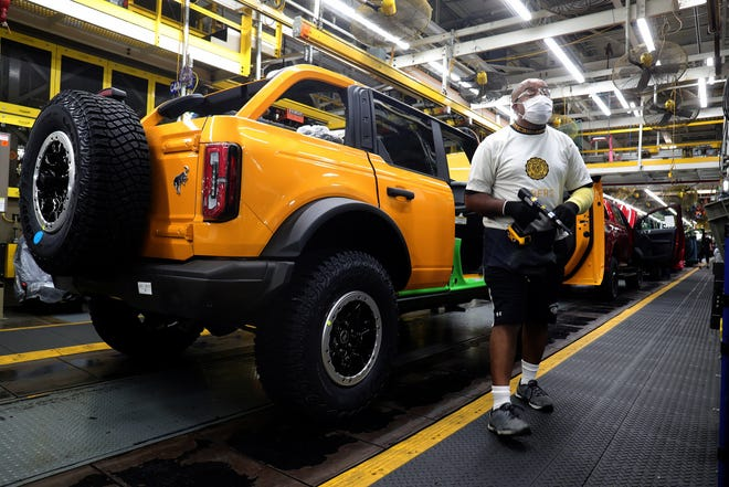 Workers turn out the new Ford Bronco on Monday, June 14, 2021, at the Michigan Assembly Plant in Wayne.