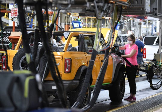 Alexis Knapp works on a Bronco during a tour of the Michigan Assembly Plant where the new Ford Bronco SUV is being built in Wayne.