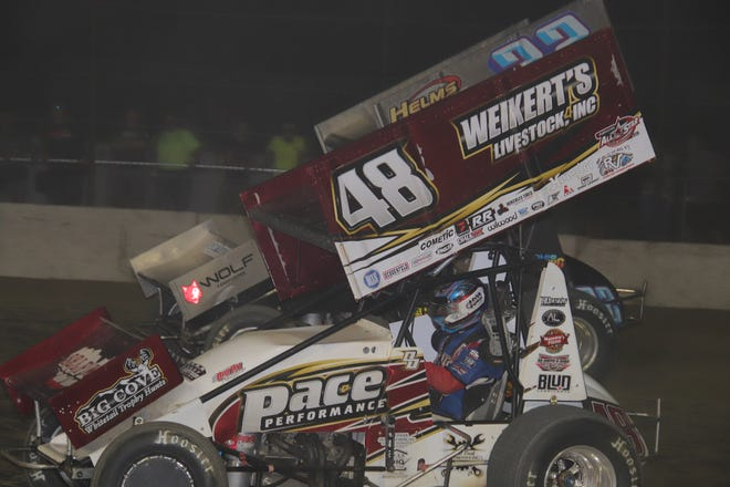 Cole Duncan, top, passes Danny Dietrich for the win on the last lap Saturday at Fremont Speedway.
