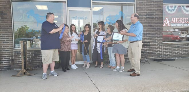The Port Clinton Chamber and Main Street Port Clinton held a ribbon-cutting ceremony to celebrate the grand opening of Little Shop by the Lake