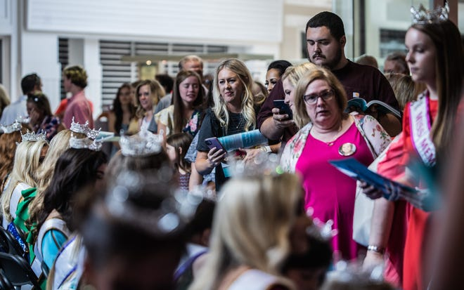 Spectators line up to get program booklets signed by Miss Tennessee Volunteer contestants during their first public appearance at Old Hickory Mall on Sunday, June 13, 2021 in Jackson, Tenn.