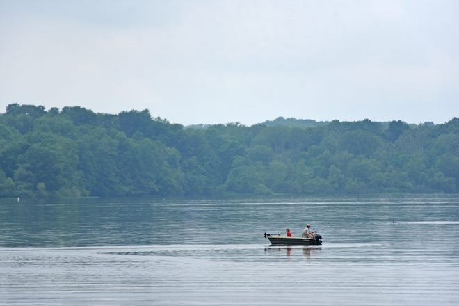 Anglers try their luck in the Clear Fork Reservoir on Friday morning. Saturday and Sunday, June 19-20, Ohio residents may fish for free in any of Ohio's public waters, including Lake Erie and the Ohio River.