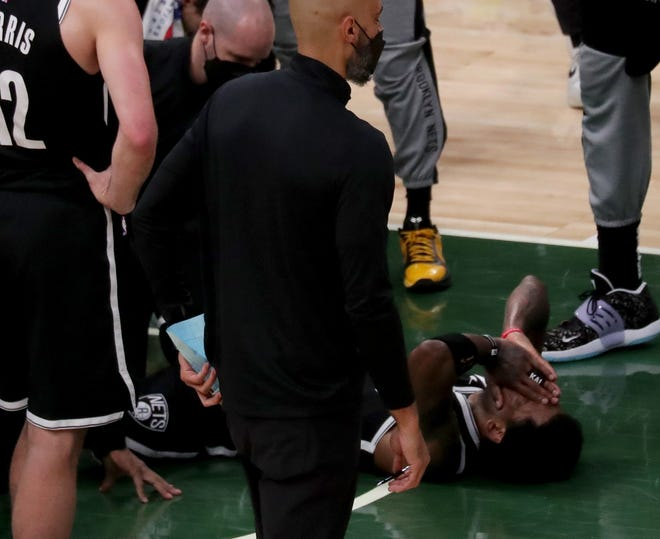 Brooklyn Nets guard Kyrie Irving (11) lays on the floor after turning a right ankle with six minutes left in the first half.