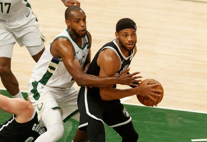 Bucks forward Khris Middleton defends Brooklyn Nets guard Bruce Brown during Game 4 of their playoff series on Sunday.