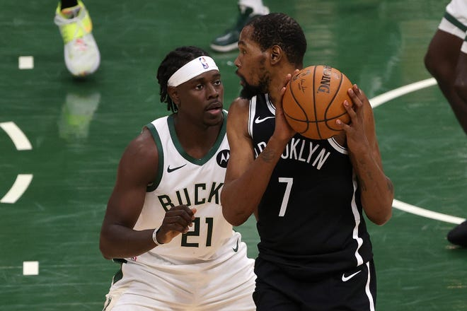 Kevin Durant of the Brooklyn Nets is defended by Jrue Holiday of the Milwaukee Bucks during Game 4 of the Eastern Conference second-round playoff series.