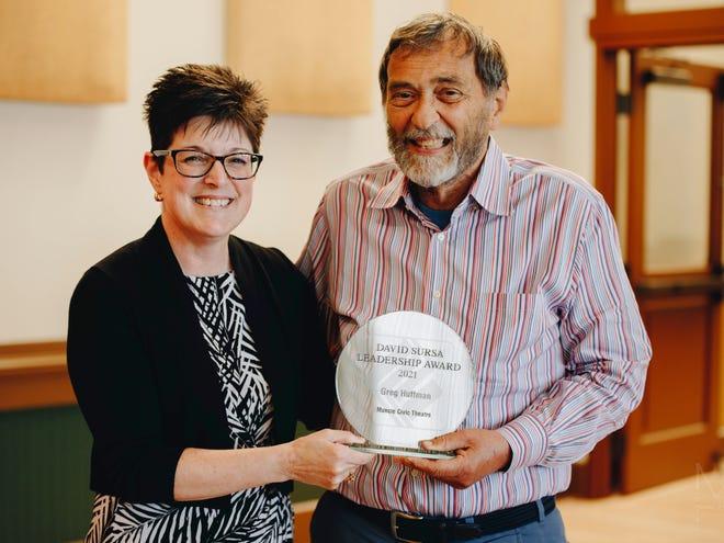 Community Foundation President Kelly K. Shrock presents the Sursa Leadership Award to Greg Huffman for his service to Muncie Civic Theatre.