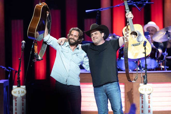Thomas Rhett, left, and his father Rhett Akins performed together at the Grand Ole Opry for the first time on Saturday, June 12, 2021.