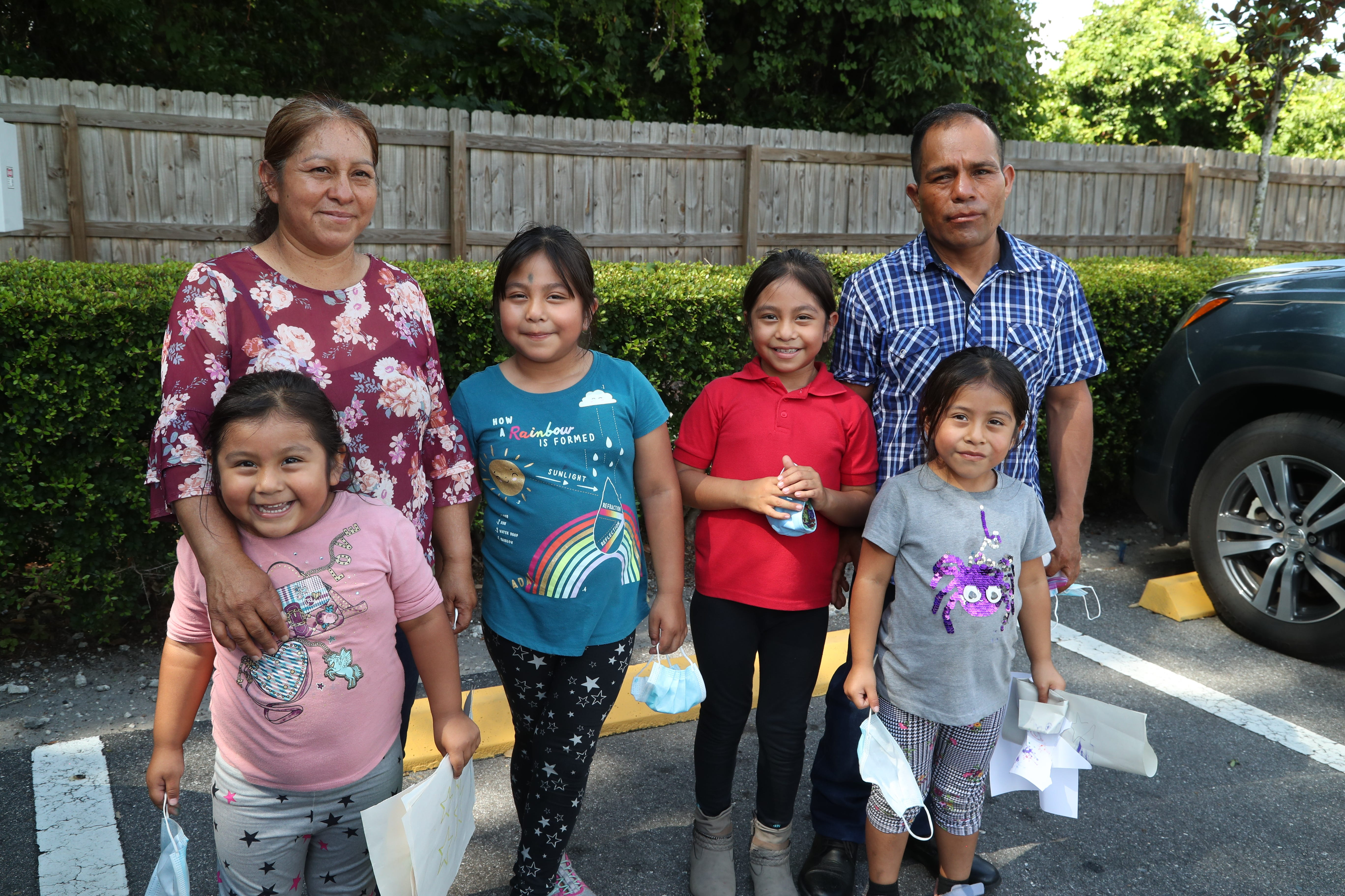 Jesus Hernandez and his wife, Julia, both farmworkers in the Plant City area, with their daughters Zaira, 4, Yaretzi, 7, Yareli, 7, and Yulisa, 5. The couple struggled to help their older girls with worksheets sent home when school closed because neither speaks English and homework instructions were in English and their girls don't yet read.