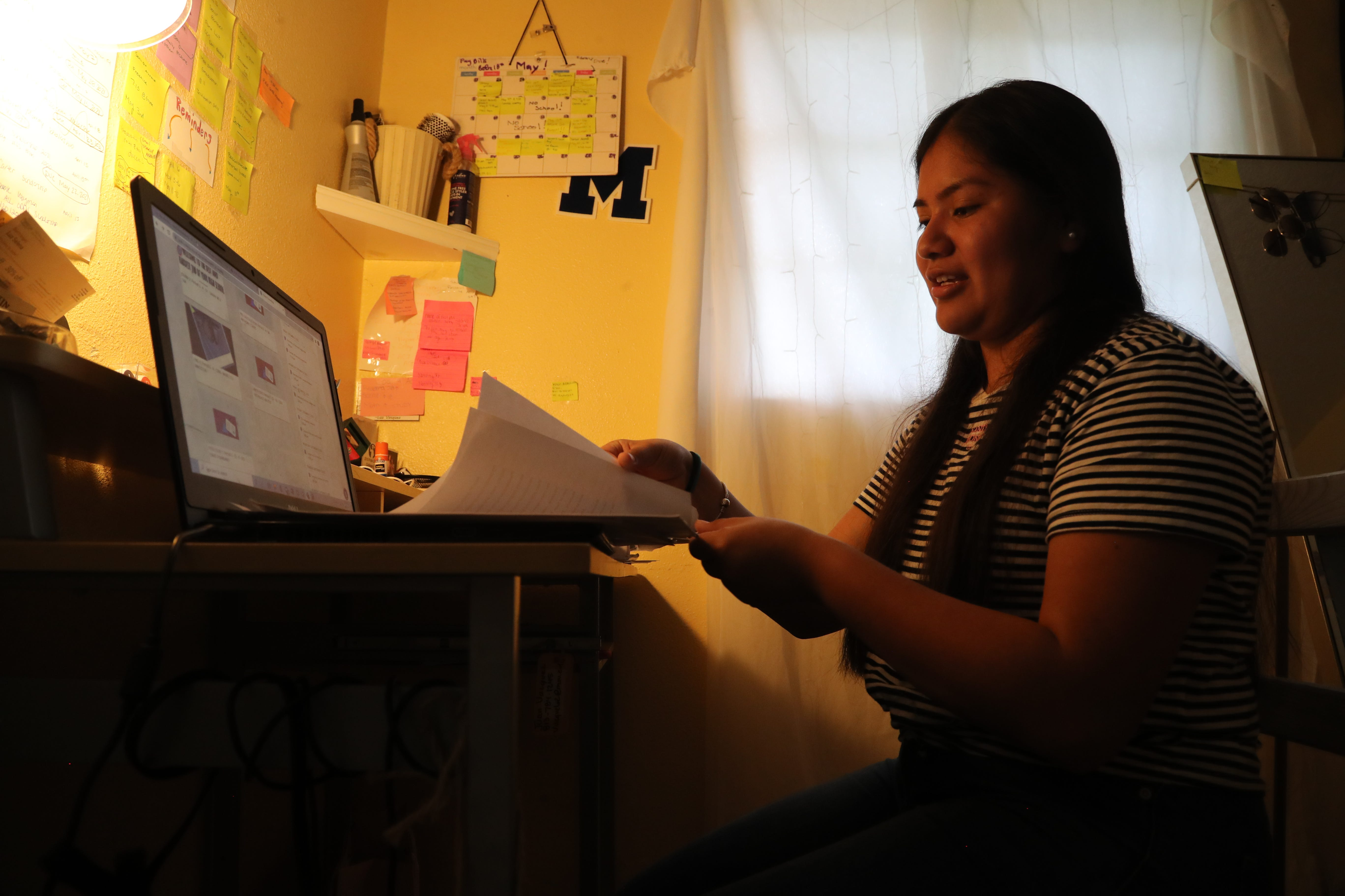 """Luz Vazquez Hernandez talks about the papers she wrote for scholarships for college. Vazquez, 18, is the daughter of farmworkers who migrate between Florida and Michigan. Shortly after her 14th birthday, she began working in the fields with her parents. Last year during the pandemic, she picked crops during the day and did her homework at night. """"I just made it work."""""""