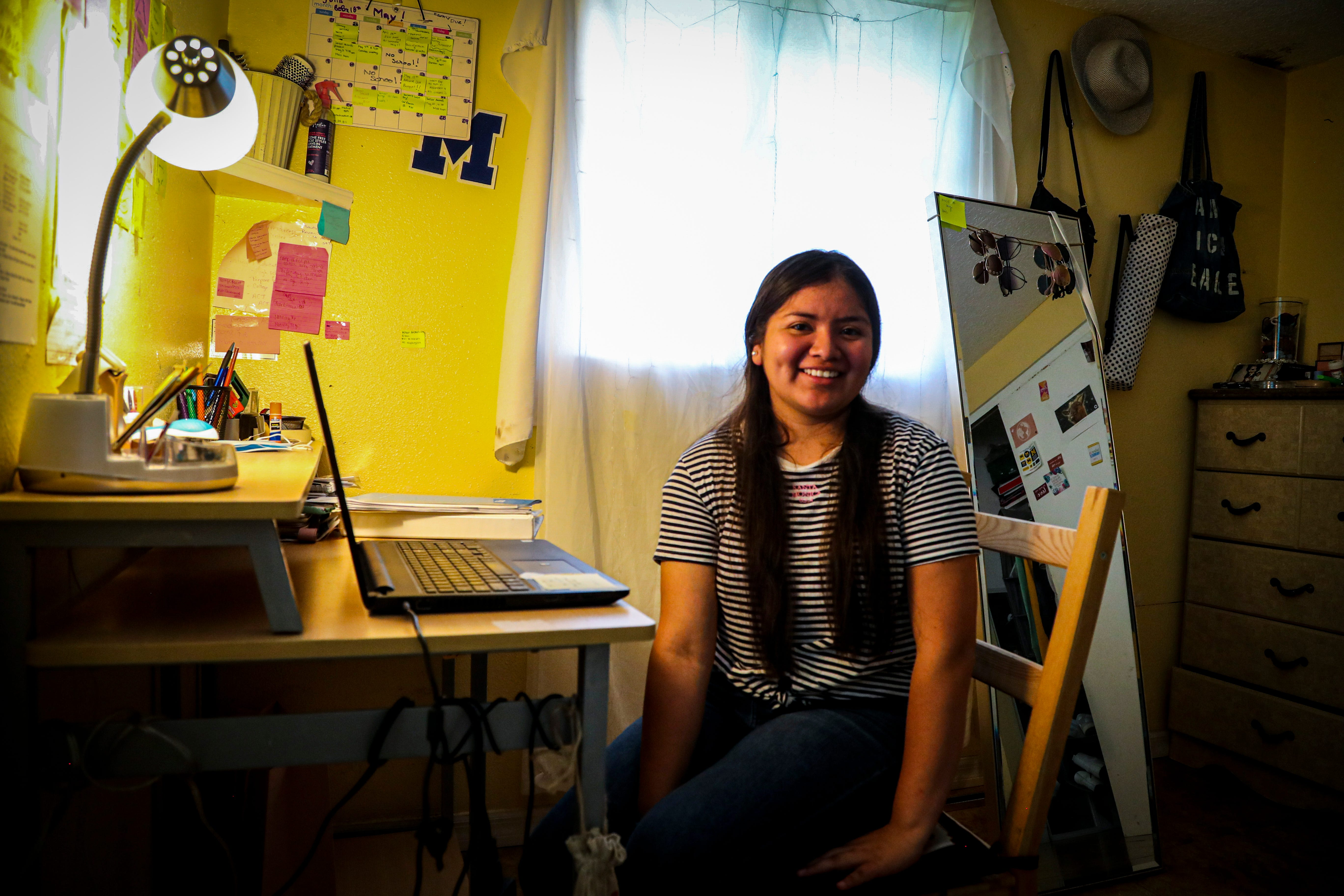 Luz Vazquez Hernandez in her room in Mulberry, Florida. This is where she spent most of her time working on homework during the pandemic. She was taking three AP classes during virtual school, which she balanced with working during the school day in the fields. This spring she graduated with a 3.9 GPA.