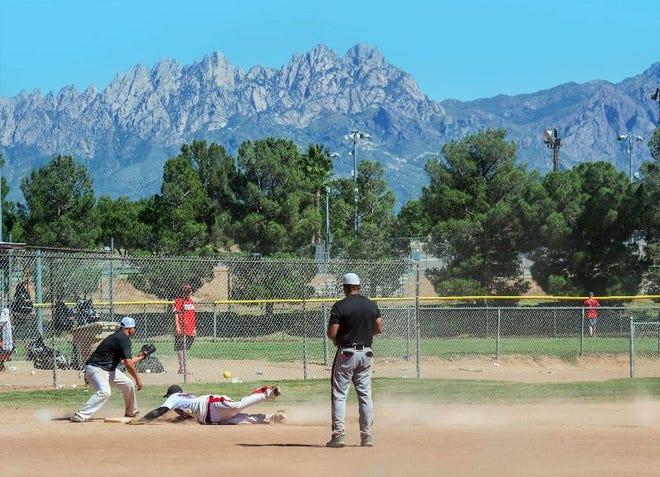 Teams play in a softball tournament at the ballfields along Hadley Avenue.