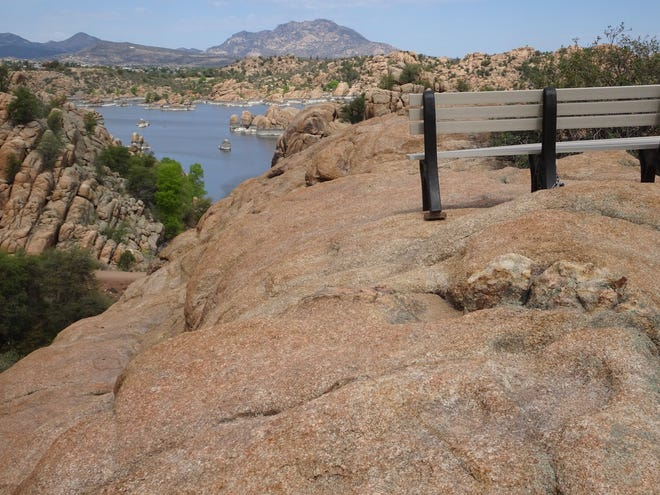 A well-placed bench offers a quiet resting place along the Easter Island Trail in Prescott's Storm Trails system.