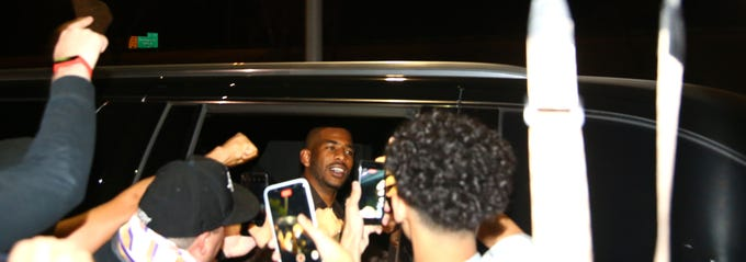 Phoenix Suns point guard Chris Paul is greeted by fans at Phoenix Sky Harbor International Airport after sweeping the Denver Nuggets in the second round of the 2021 NBA Playoffs on June 13, 2021.